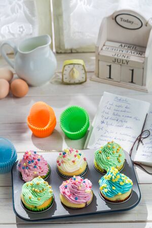 Preparation for tasty cupcakes with cream photo