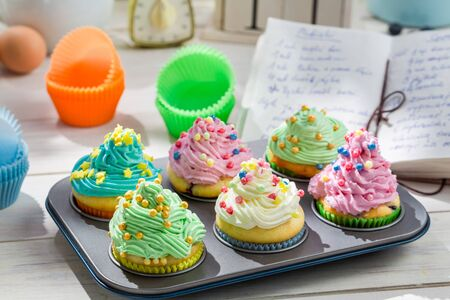 Preparation for sweet cupcakes with cream and decoration photo
