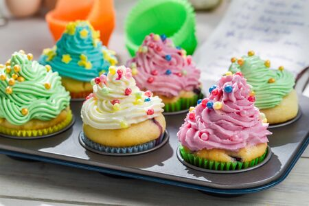Preparation for delicious muffins with sweet cream photo