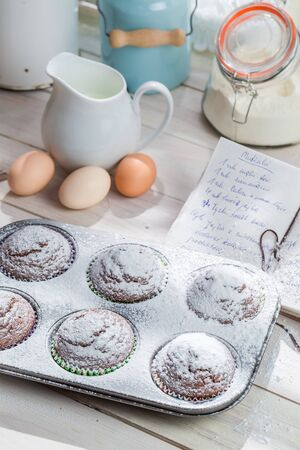 caster: Decorating delicious muffins with caster sugar Stock Photo