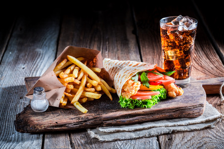 Fresh kebab with cod drink and fries
