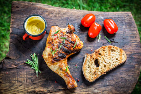Roasted chicken leg with rosemary and pepper photo