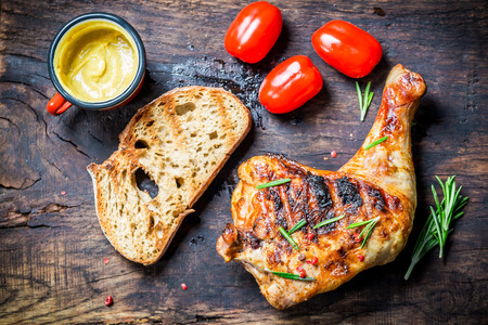 bbq chicken: Grilled chicken leg with toast and cherry tomato