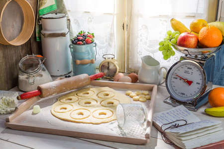 rustic kitchen: Baking homemade donuts in the rustic kitchen Stock Photo