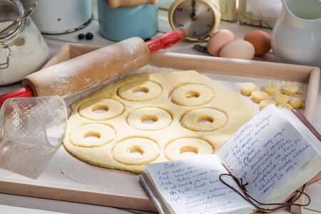 rustic kitchen: Preparation for homemade donuts in the rustic kitchen Stock Photo