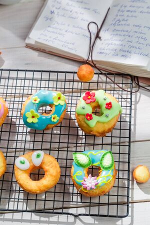 rustic kitchen: Decorating delicious donuts in the rustic kitchen Stock Photo