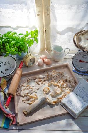 preparations: Preparations for tagliatelle in the sunny kitchen Stock Photo