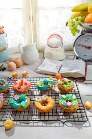 rustic kitchen: Decorating tasty donuts in the rustic kitchen
