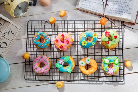 rustic kitchen: Decorating homemade donuts in the rustic kitchen