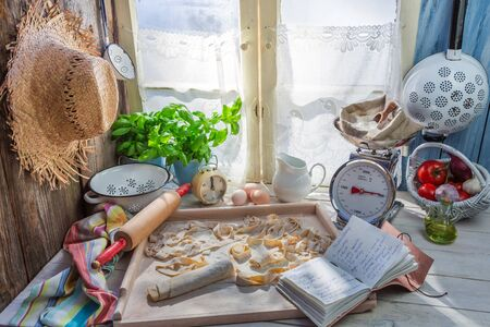 preparations: Preparations for tagliatelle in the rustic kitchen Stock Photo