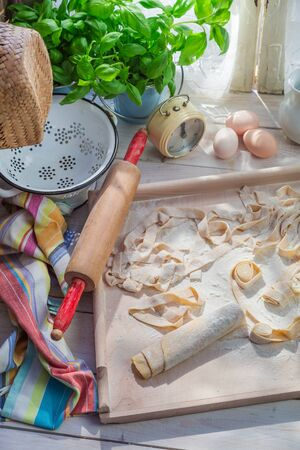 preparations: Preparations for pappardelle in the rustic kitchen Stock Photo