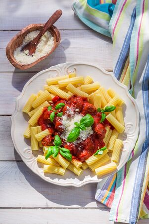 Homemade pasta penne in the sunny kitchen photo