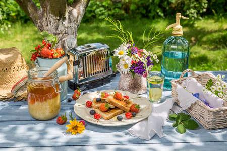 breakfast garden: Breakfast in the garden with toast and fruit Stock Photo
