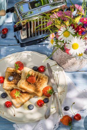 breakfast garden: Coffee, toast and fruit for breakfast in the garden Stock Photo