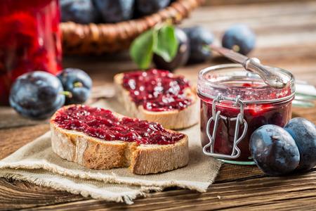 jam jar: Sandwich with plum jam Stock Photo