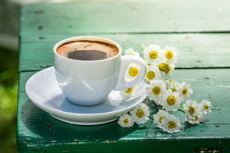Delicious hot coffee with flowers