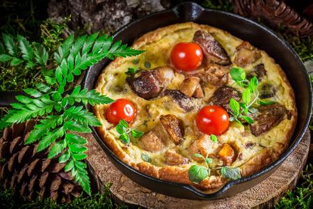 Tasty scrambled eggs with mushrooms