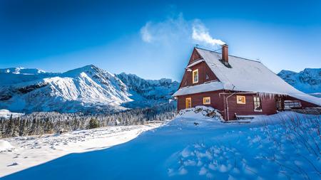 Warm accommodation in a mountain cottage in winter Reklamní fotografie