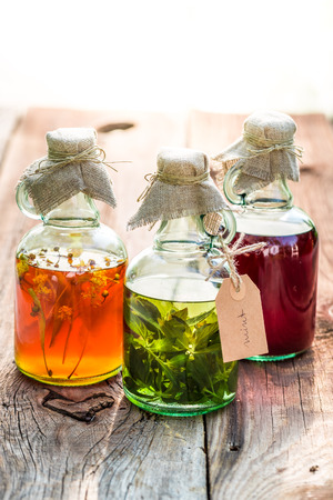 witchdoctor: Healthy herbs in bottles as natural medicine