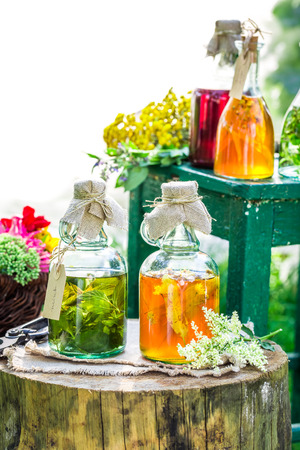witchdoctor: Healing herbs in bottles with alcohol and herbs