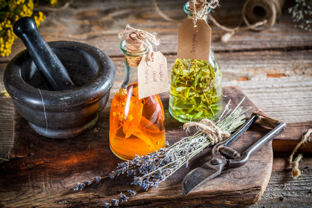 tincture: Homemade tincture in bottles with alcohol and herbs