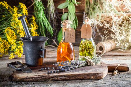witchdoctor: Homemade herbs in bottles with herbs and alcohol