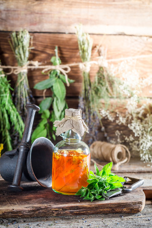 witchdoctor: Therapeutic herbs in bottles as homemade cure