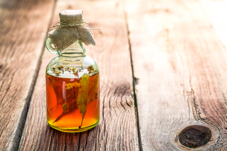 witchdoctor: Healthy herbs in bottles as homemade cure Stock Photo