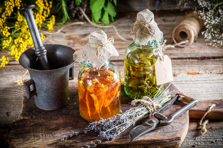 tincture: Homemade tincture in bottles as natural medicine Stock Photo