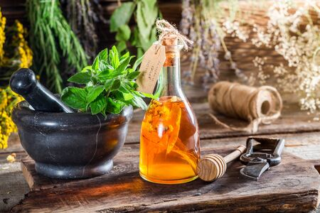 tincture: Aromatic tincture with herbs and alcohol Stock Photo