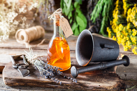 witchdoctor: Aromatic herbs in bottles with alcohol and herbs