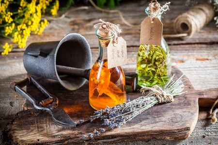 witchdoctor: Homemade herbs in bottles as natural medicine Stock Photo