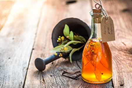 witchdoctor: Healthy herbs in bottles with alcohol and herbs Stock Photo