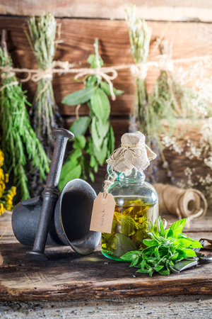 witchdoctor: Therapeutic herbs in bottles as natural medicine Stock Photo