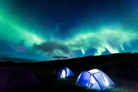 Camp with Northern lights in Iceland Stock Photo