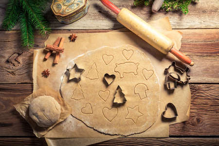 gingerbread cookies: Cutting Christmas gingerbread cookies Stock Photo
