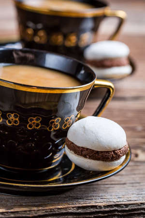 albumen: Cup of coffee and one little macaroon
