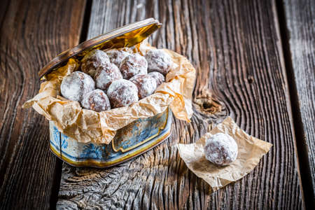 sweet table: Sweet cocoa balls with powder milk in old box Stock Photo