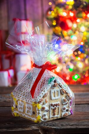 decorating christmas tree: Tasty and sweet gingerbread cottage Stock Photo