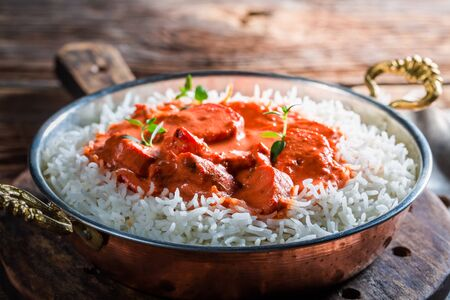 exotically: Sweet and spicy tikka masala with rice and tomato sauce Stock Photo