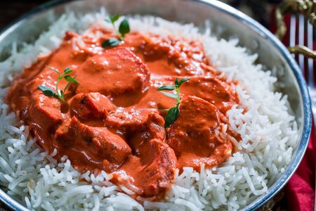 exotically: Delicious tikka masala with rice and chicken Stock Photo