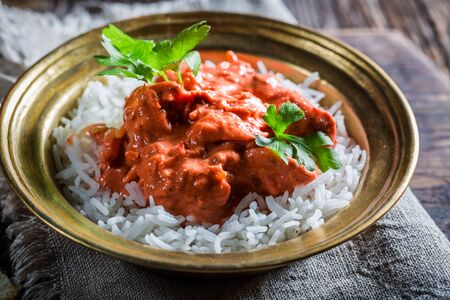 exotically: Spicy tikka masala with rice and chicken