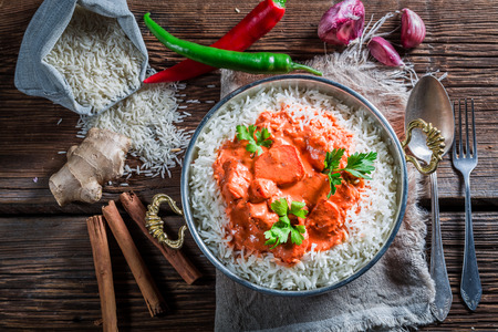 exotically: Sweet and spicy tikka masala with rice and chicken in tomato sauce