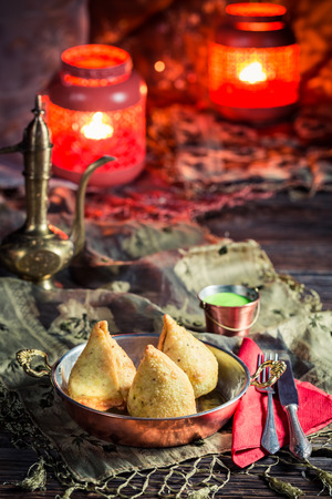 curry dish: Fried samosa with vegetables and meat Stock Photo