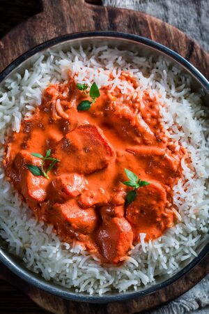 exotically: Sweet and spicy tikka masala with rice and chicken Stock Photo