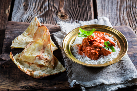 Madras: Indian tikka masala with rice and sauce Stock Photo