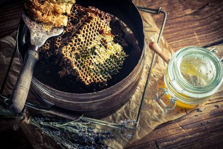 apiarist: Old beekeeper tools with honey