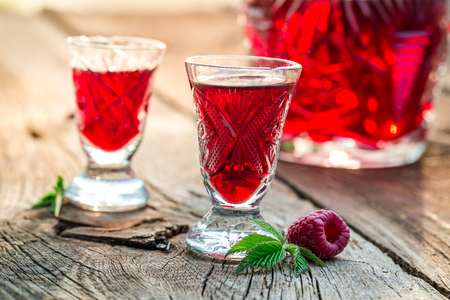 liqueur: Sweet liqueur with raspberries and alcohol Stock Photo