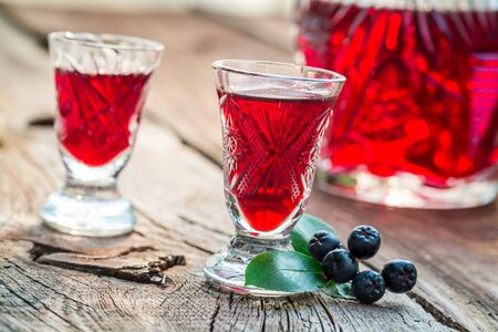 liqueur: Homemade liqueur with chokeberries and alcohol