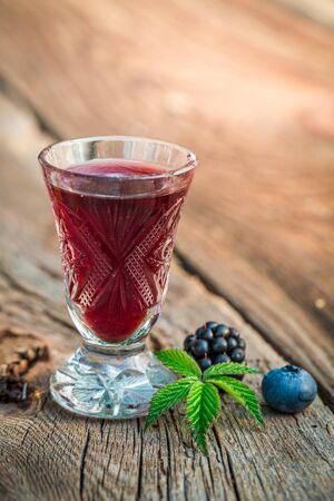 liqueur: Homemade liqueur with berry fruits and alcohol